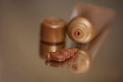 Selbstbräunung, die Lotion bronziert lizenzfreie stockfotos