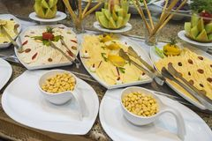 Selction of cold cheese salad food at a restaurant buffet Stock Photo