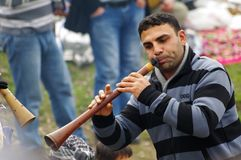A gypsy man performing music by traditional Turkish clarion stock photos