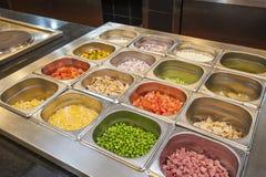 Seleção de artigos da salada em um bufete Imagens de Stock Royalty Free