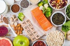 Seleção dos superfoods no fundo rústico Fotografia de Stock
