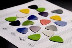 Selección colorida de la guitarra en una hoja en blanco Imagen de archivo libre de regalías