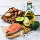 Selección de comida gorda sana de las fuentes, concepto de la vida Fotografía de archivo