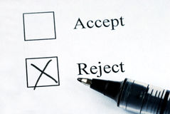 Select the Reject option. With a pen Royalty Free Stock Images