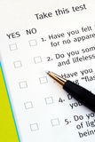 Select Yes or No from a questionnaire. With a pen Stock Photo