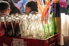 Selected Focus. A collection of old and vintage coca cola bottle. Kanchanaburi,Thailand- May 8,2018: Selected Focus. A collection of old and vintage coca cola royalty free stock photo