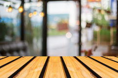 Selected focus empty brown wooden table and Coffee shop blur bac Stock Photo