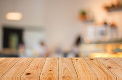 Selected focus empty brown wooden table and Coffee shop blur bac Royalty Free Stock Photo