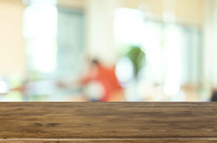 Selected focus empty brown wooden table and Coffee shop blur bac Stock Photography