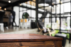Selected focus empty brown wooden table and Coffee shop blur bac Stock Image