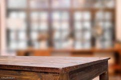Selected focus empty brown wooden table and Coffee shop blur bac Royalty Free Stock Photos
