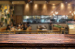 Selected focus empty brown wooden table and Coffee shop blur bac. Kground with bokeh image, for product display montage Stock Photo