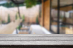 Selected focus empty brown wooden table and Coffee shop blur bac. Kground with bokeh image. for your photomontage or product display Stock Image