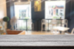 Selected focus empty brown wooden table and Coffee shop blur bac. Kground with bokeh image. for your photomontage or product display Royalty Free Stock Images
