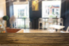 Selected focus empty brown wooden table and Coffee shop blur bac Royalty Free Stock Photography