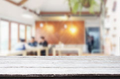 Selected focus empty brown wooden table and Coffee shop or resta Royalty Free Stock Photos