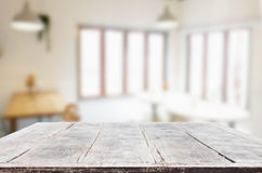 Selected focus empty brown wooden table and Coffee shop or resta. Urant blur background with bokeh image. for your photomontage or product display Royalty Free Stock Images