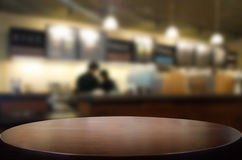 Selected focus empty brown wooden table and Coffee shop restaura. Nt blur background with bokeh image. for your photomontage or product display Royalty Free Stock Photos