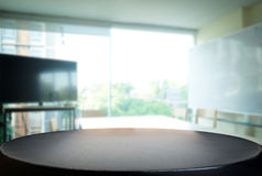 Selected focus empty brown wooden table and meeting room or offi Royalty Free Stock Photography