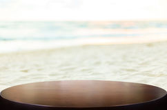Selected focus empty brown wooden table on the tropical sea beach and sunny day and space for product display montage. Selected focus empty brown wooden table royalty free stock photo