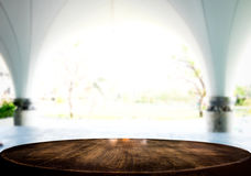 Selected focus empty brown wooden table and white texture or out. Doors blur background image. for your photomontage or product display Royalty Free Stock Photo