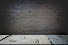 Selected focus empty gray wooden table and wall texture or old b. Lack brick wall blur background image. for your photomontage or product display Stock Images