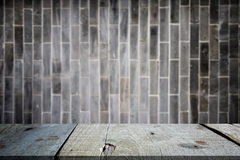 Selected focus empty gray wooden table and wall texture or old b. Lack brick wall blur background image. for your photomontage or product display Royalty Free Stock Photos