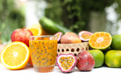 Selected Focus glass of fresh passionfruits and vegetables Stock Images
