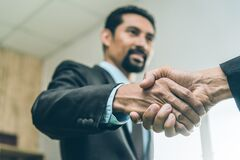 Free Selected Focus On Two Businessman Hands Shake In The Meeting Room. Businessmand Hand Shake As A Greeting Stock Image - 182803371