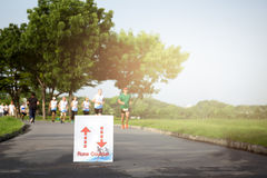 Selected focus on running sign group of people jogging in the pa Stock Photography