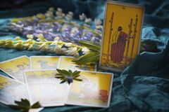 Free Selected Focus Tarot Cards On A Blue Background With Flowers Royalty Free Stock Photos - 187893838