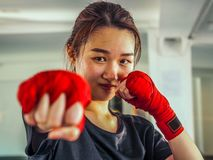 Selected focus of young beautiful women wear a red Thai boxing tape ready for punching royalty free stock images
