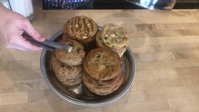 Selecting chocolate cookie from jar. Selecting a chocolate cookie from glass jar stock video footage