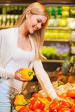 Selecting freshness and quality. Royalty Free Stock Photos