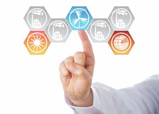 Selecting Solar, Wind And Geothermal Energy. Solar, wind and geothermal power generation icons being chosen by the hand of a business man. Three activated Royalty Free Stock Photography