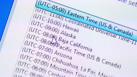 Selecting time zone on a computer Stock Images