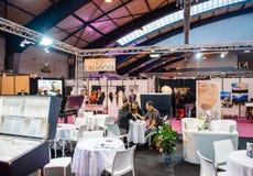 Selecting wedding ring at Salon du Marriage wedding fair France Royalty Free Stock Image
