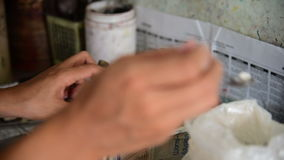 Selecting and weighting powder colors for batik stock video footage