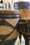Selection of African drums. A selection of ornate African drums made of wood and animal skin Royalty Free Stock Photos