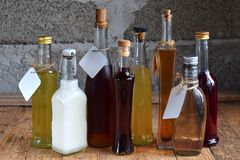 Selection of alcoholic drinks. Set of wine, brandy, liqueur, tincture, cognac, whiskey bottles. Large variety of alcohol and spiri. Ts for making cocktails and Stock Photo
