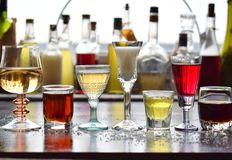 Selection of alcoholic drinks. Set of wine, brandy, liqueur, tincture, cognac, whiskey in glasses, bottles. Large variety of alcoh stock photo
