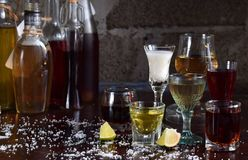 Selection of alcoholic drinks. Set of wine, brandy, liqueur, tincture, cognac, whiskey in glasses, bottles. Large variety of alcoh royalty free stock photos