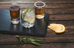 Selection of alcoholic drinks on slate board on rustic wood back Stock Photo