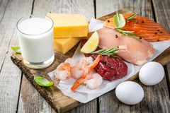 Selection of aminal protein sources on wood background stock photo