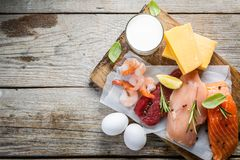 Selection of aminal protein sources on wood background stock image