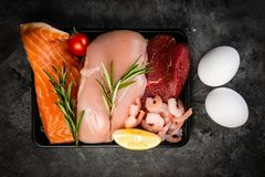 Selection of aminal protein sources on wood background stock photography