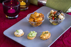 Selection of Appetizers on Square Plate on Table Royalty Free Stock Photo