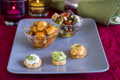 Selection of Appetizers on Square Plate on Table Stock Image