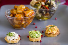 Selection of Appetizers on Square Plate on Table Stock Photo