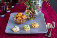 Selection of Appetizers on Square Plate on Table Stock Photos